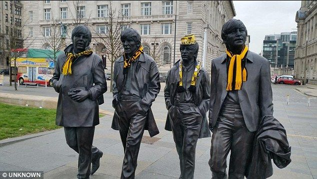 Dortmund fans have made their mark in Liverpool by putting Dortmund scarves on a famous Beatles statue