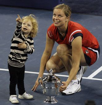Kim Clijsters and her daughter Jada pose with the championship trophy after Clijsters defeated Caroline Wozniacki 7-5, 6-3 in the women's final. Clijsters also won the U.S. Open in 2005, the last time she played in the tournament. (2009)