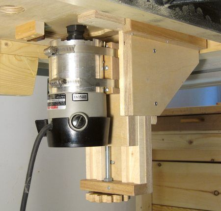 Router Lift by Matthias Wandel -- Homemade router lift featuring wooden slides and gears. http://www.homemadetools.net/homemade-router-lift