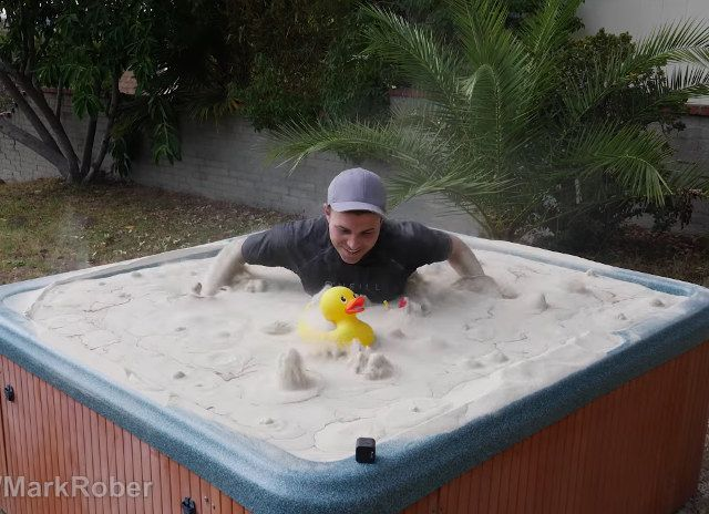 """Playing In A Hot Tub Full Of Fluidized Sand   This is a video of Mark Rober discussing the physics of fluidized beds, """"a physical phenomenon occurring when a quantity of a solid particulate subs... http://drwong.live/weird/playing-in-a-hot-tub-full-of-fluidized-s-php/"""