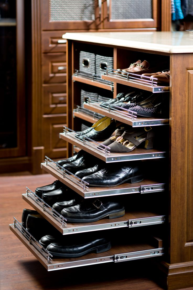 Pull out shoe rack in a dressing room island. These pull outs can be added anywhere and to any depth of shelf. They are most effective located lower than waist level to aid in seeing to the back of deep shelves at low levels. An excellent investment if you prefer this to drawers at a lower level. Very useful for shoes and bag storage.