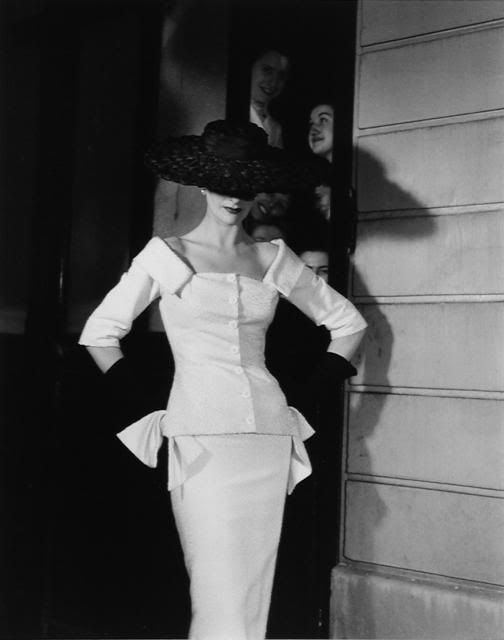 Model wearing a suit by Jacques Fath, 1955.