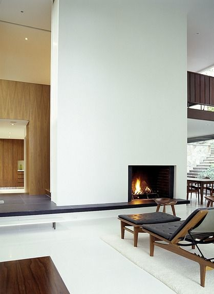 Would make an absolutely stunning lobby or waiting room. Sleek minimal design, but the wood and fire keep it from starkness. BassamFellows