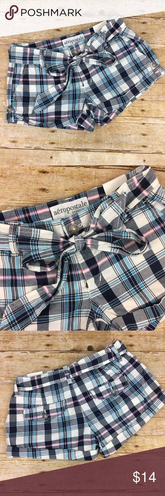 Aéropostale plaid stretch shorts with tie belt 3/4 Aéropostale plaid stretch shorts with tie belt. Navy, ligh bkue, pink and white.  About a 29 inch waist, 9 inches long, 2.5 inseam, 7 inch rise. Aeropostale Shorts