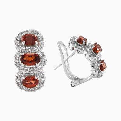 This earrings is made of three diamonds halos which surround the big central garnet. Total weight of sparkle diamonds is 0.24 ct, and total weight of garnet is 1.67 ct. Made entirely by hand in 18k white gold.