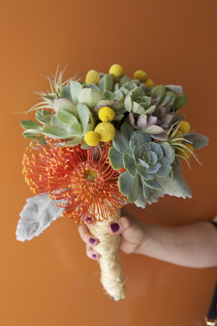 succulent bouquet with yellow pincushion protea