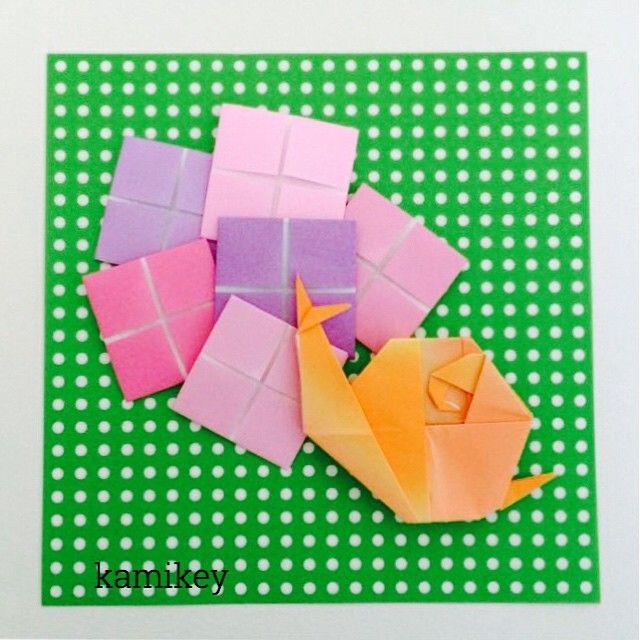 May 31, 2015 * Snail folded from bird base * 前回のヨーダもそうですが、このかたつむりも鶴の基本形から折っています今週は鶴の基本形から作る生き物シリーズで! * #origami#design#originalart#create#おりがみ#折り紙#handmade#ハンドメイド#オリジナル#snail#かたつむり