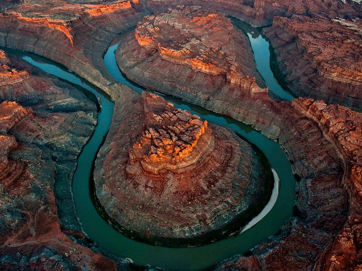 """Canyonlands National Park, Utah  Photograph by Peter McBride, National Geographic    """"The Loop,"""" six miles above the confluence of the Green and Colorado Rivers, snakes its way through Canyonlands National Park, a remote expanse in southeastern Utah. Canyonlands protects one of the most unspoiled areas of the vast Colorado Plateau, full of canyon mazes, unbroken scarps, and sandstone pillars."""