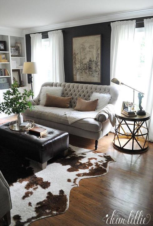 living room - paint color + curtains + bookcases + sofa + ottoman