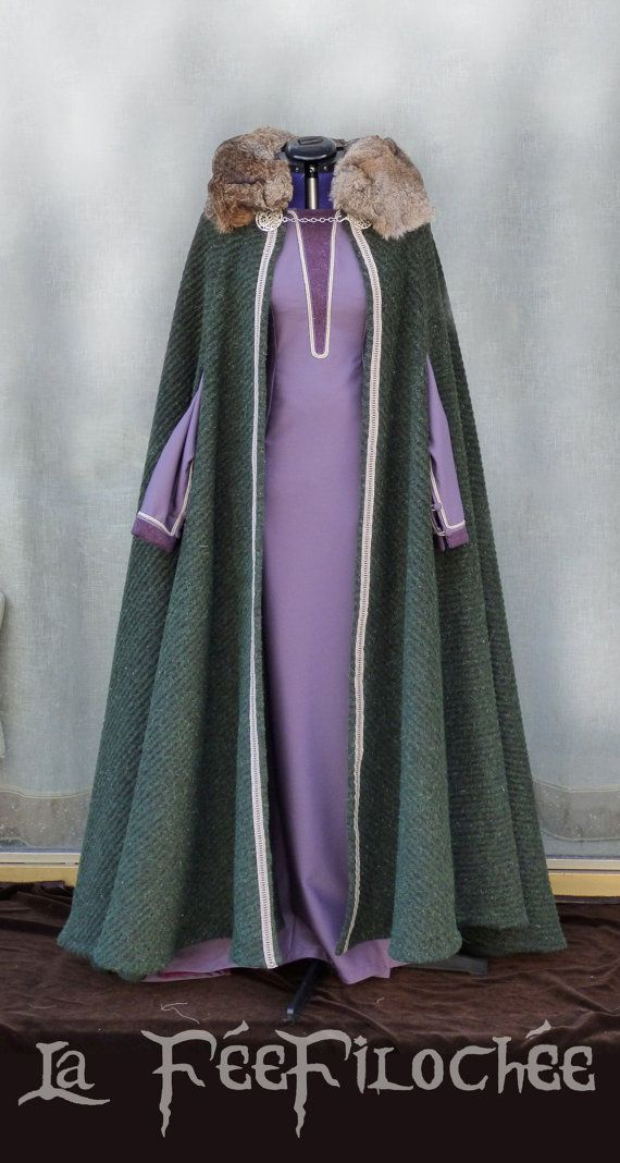 Full viking costume made of a woolen fabric cloak with real fur collar and a long-sleeves dress of purple light woolen fabric laced at the back and
