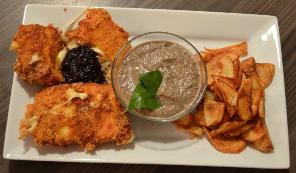 Fried cheese with french fries and mushroom sauce