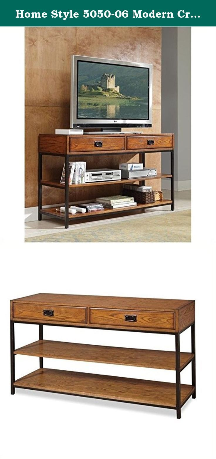 Home Style 5050-06 Modern Craftsman Media Console, Distressed Oak Finish. The modern craftsman entertainment collection marries a traditional, multi-step distressed Oak finish on poplar solids and oak veneers with new age, brown metal accents. Features includes two storage drawers and two fixed shelves. The modern craftsman TV stand can function as a media console or as a larger console table. Easy to assemble. Measures 54-inch width by 18-inch depth 31-1/2-inch height.