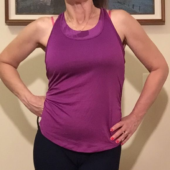 Mountain Hard Wear workout top Built-in sports bra with tank over. Ruching at sides. Straps cross and twist in the back. Mountain Hard Wear Tops Muscle Tees