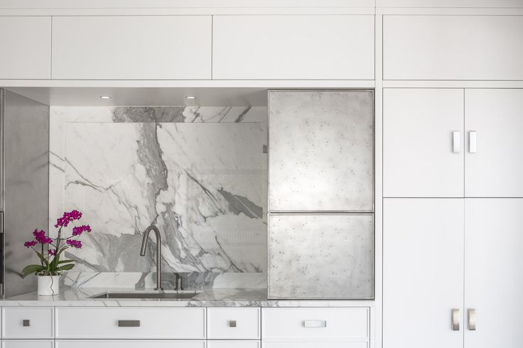 A white-washed & caluctta marble kitchen design in Ottawa, Canada.  Design by Astro Design Centre. Aster Cucine Cabinetry via Astro