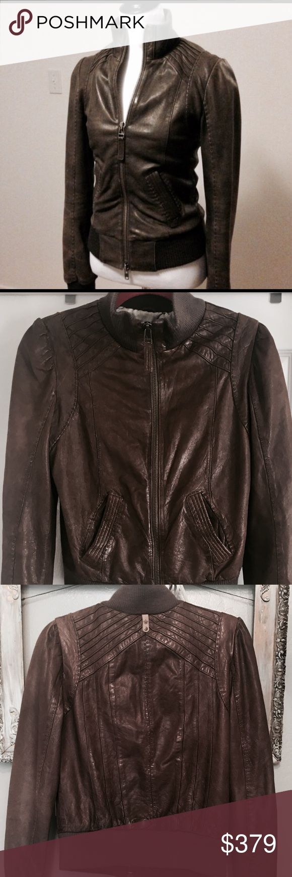 """MACKAGE """"JERRY"""" LEATHER BOMBER JACKET M MSRP $550 NWOT Mackage  """"JERRY"""" leather bomber in perfect condition (retail $550). This style was made exclusively for Aritzia. MEASUREMENTS : armpit to armpit flat side to side: 19""""  SLEEVE LENGTH: from armpit to bottom: 18""""  SHOULDER TO SHOULDER AT WIDEST: 15 1/2""""  LENGTH FROM TOP OF SHOULDER TO BOTTOM: 22 1/2"""" Color is a deep rich brown. Fully lined. Two from open slant pockets. Beautiful detailing and double stitching. Leather is lamb and trim is…"""