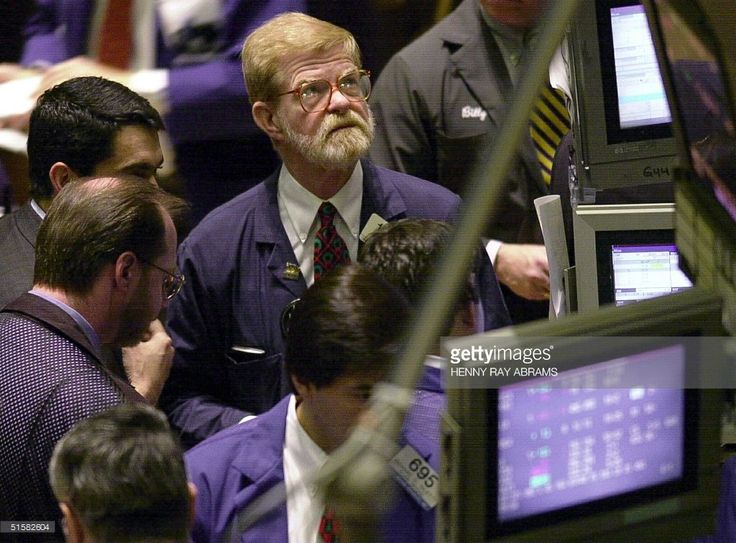 The Dow Jones Industrial Average fell sharply at the opening bell on news that Microsoft had issued their first earnings warning in 10 years. Microsoft's woes dragged down the other tech members of the DJIA, including Intel and IBM. Traders on the floor of the New York Stock Exchange keep an eye on the numbers. AFP PHOTO/Henny Ray ABRAMS