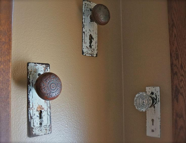 old vintage hardware & repurposed door knobs make great robe and towel hangers in a farm house bathroom.