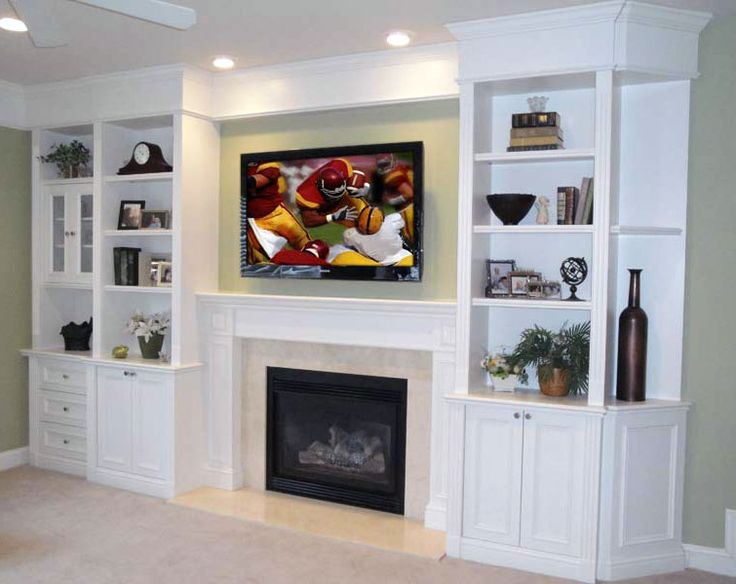 built in shelving, tv over fireplace