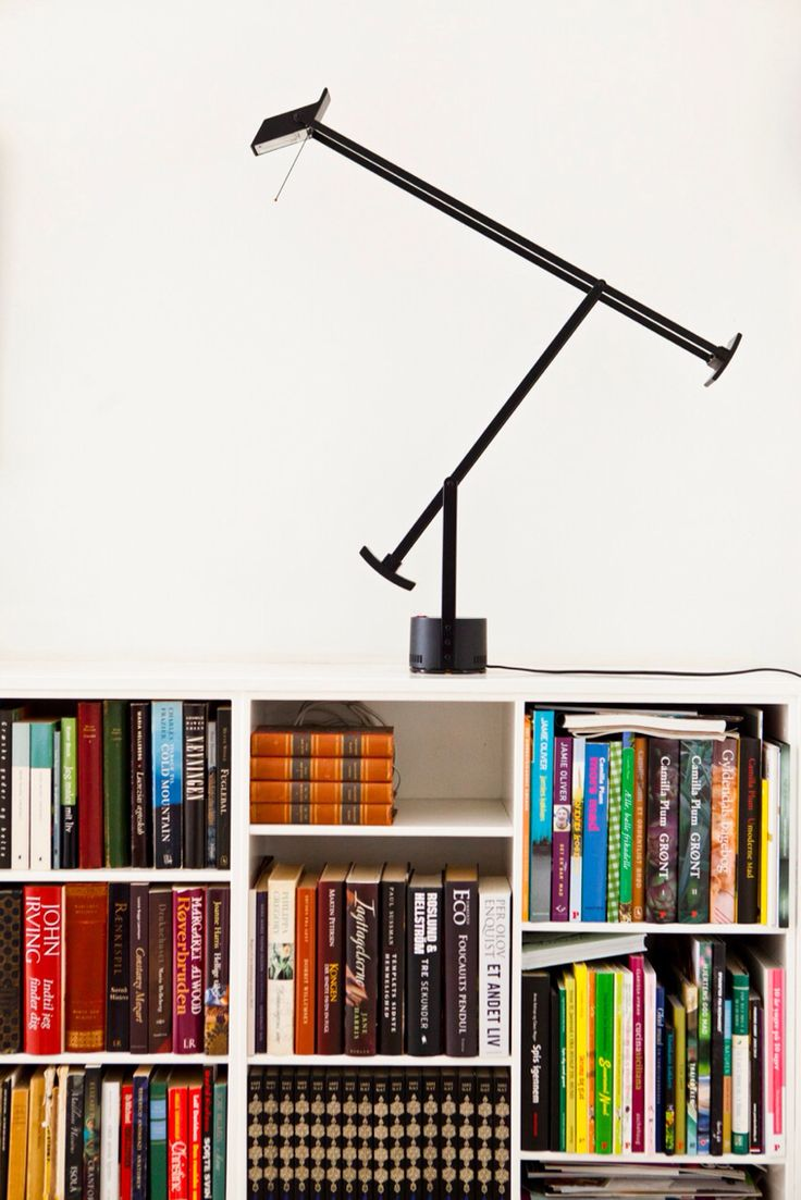 Books and Artemide Tezio.