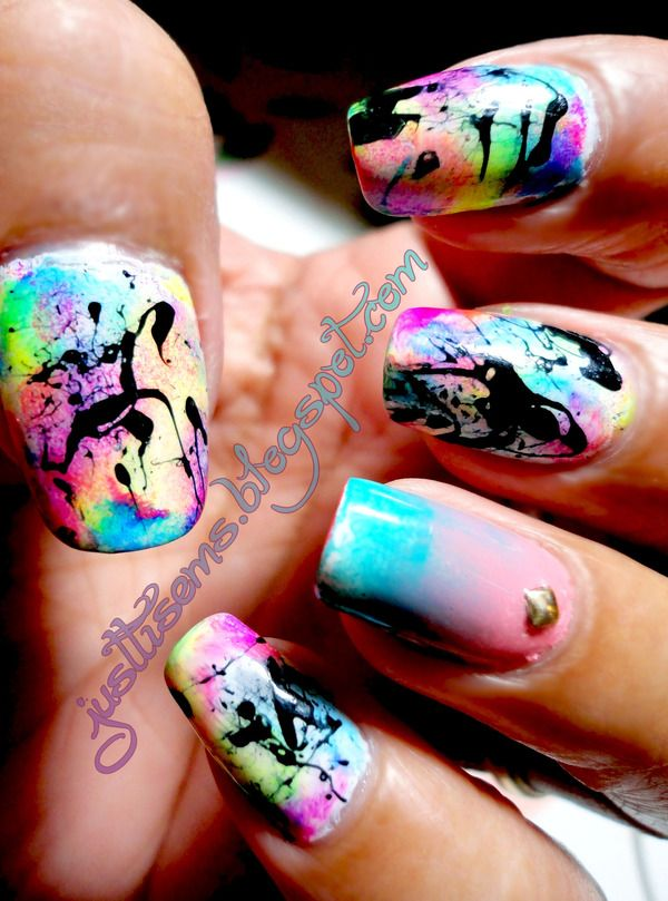 I love doing splatter nails. Hmmm... Maybe that'll be the new mani of the day.