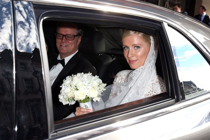 On the way to Kensington Palace with her father Richard Hilton.