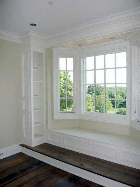 Bay window with a built in book shelf
