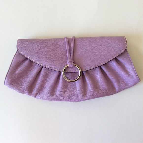 HP 3/13 BCBG MaxAzria Purple Clutch This cute light purple clutch includes the following features: pebbled leather, gathered design, buckle at front closure, snap closure, 3 pockets on inside (2 open, 1 zipper), also has 6 inch strap, L14 x H7.5 x W3, new without tags, never worn. BCBGMaxAzria Bags Clutches & Wristlets
