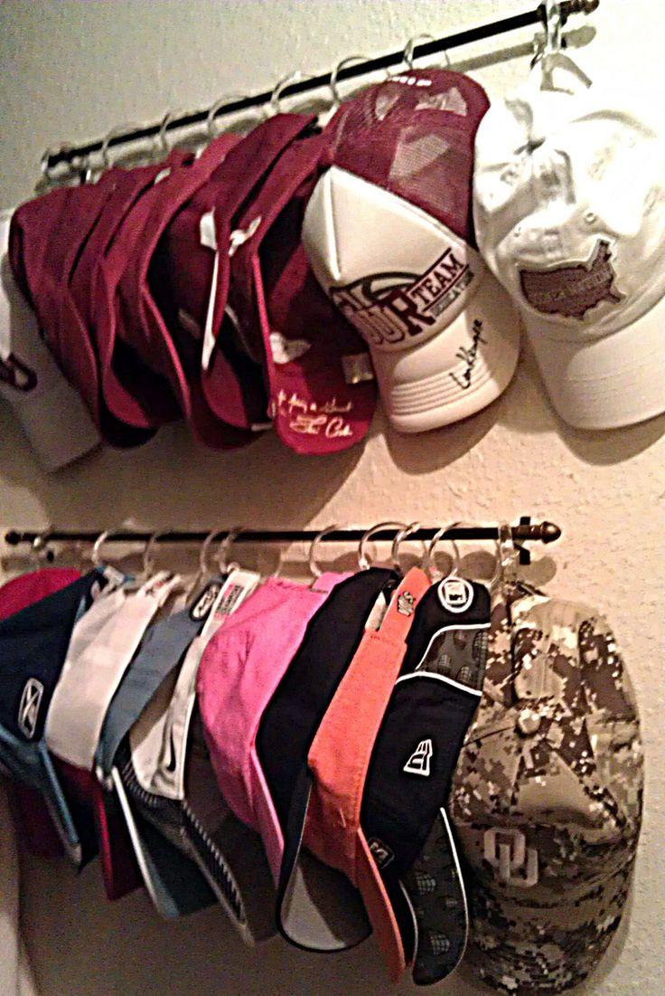 Another great use of a simple curtain rod (or towel rack). ~~~ What a great, inexpensive, & easy way to make a cap rack.