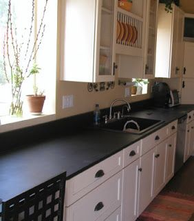 Black Formica Countertops With White Beadboard Cabinets
