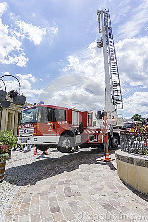 A Fire engine truck with ladder in air on a firefighting show in Austria, Eisenstadt.