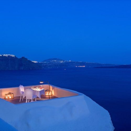 Enjoy a private candle lit dinner with your loved one at the Canaves Oia Suites