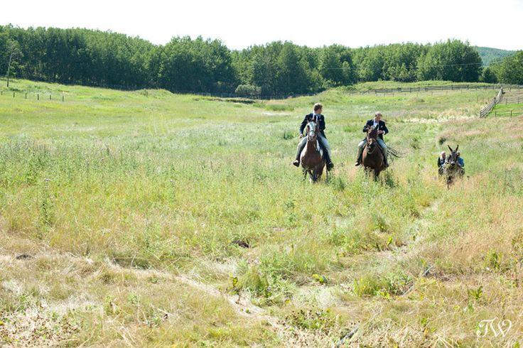 Calgary wedding photographers   Groom and groomsmen arrived on horseback at 7K Panorama Ranch