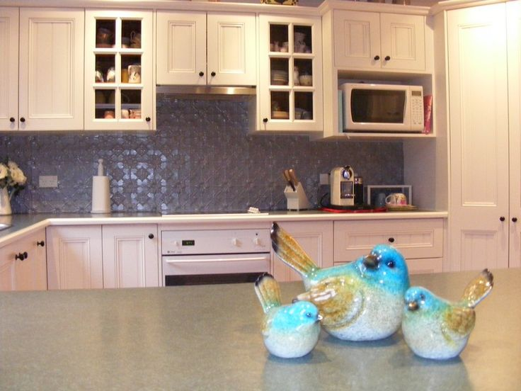 Kitchen refurbishment with pressed tin & white painted cupboards