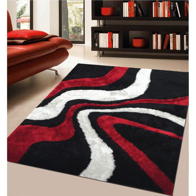 This stunning area rug is easy to clean and vacuum, while adding style to any room. The hand-tufted polyester is designed in red, white and black geometric patterns.