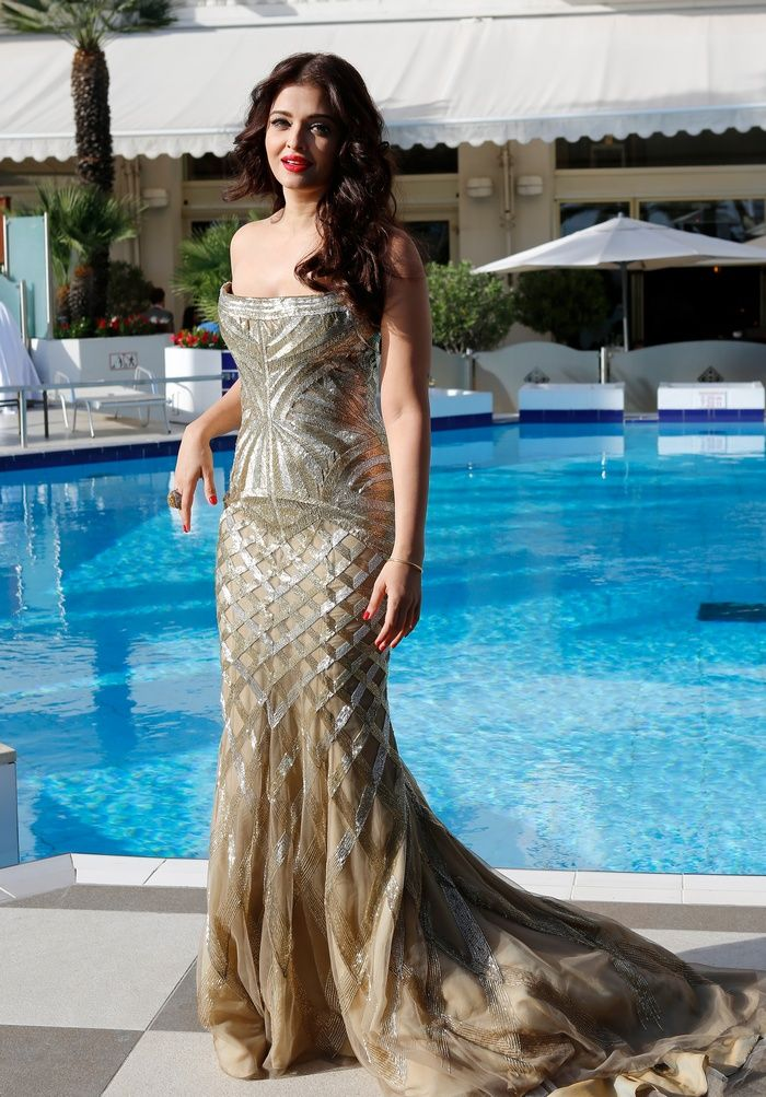 Aishwarya Rai Bachchan by the poolside. #Style #Bollywood #Fashion #Beauty #Cannes2014