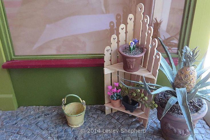 Shabby Chic corner unit for a dollhouse made from miniature fence pickets shaped from coffee stir sticks or craft wood.