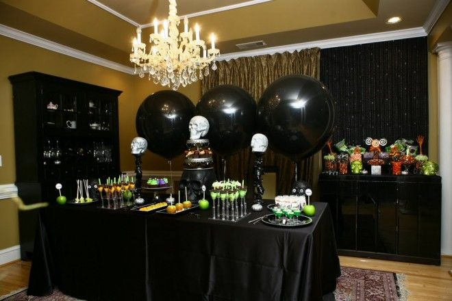 Haunted House Halloween Party - This is a seriously cool looking party complete with a Poisoned Popcorn Bar, and recipes for Eyeball Jello Shots, Pumpkin Spice S'more Push Pops, and Pushing Daisies Parfait Cups.