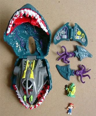 mighty max. my brother had these. it was like the male version of polly pocket.