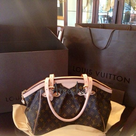 Thinking of selling her finally ! Louis Vuitton Tivoli GM authentic of course. Gently used. No stains, smells, light patina. Will be authenticated by Poshmark before delivery. Louis Vuitton Bags