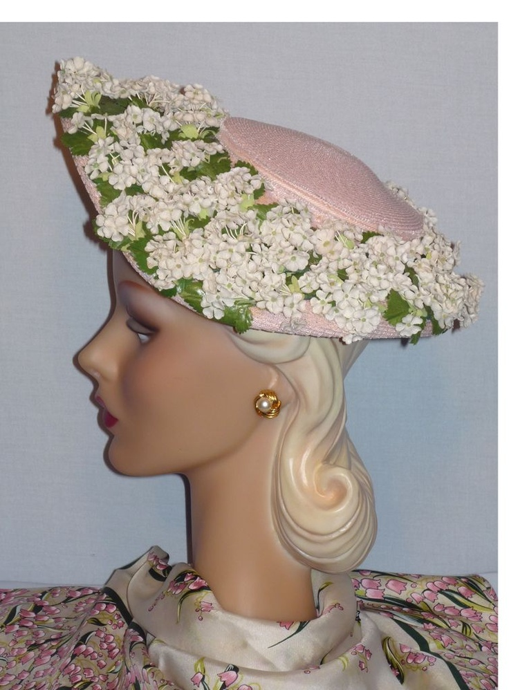 """1950's pink straw dish hat with showers of forget-me-nots (side view) 