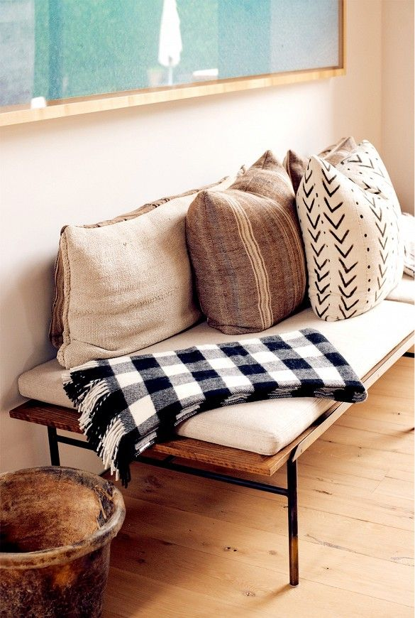 Cozy plaid wool throw and seating bench