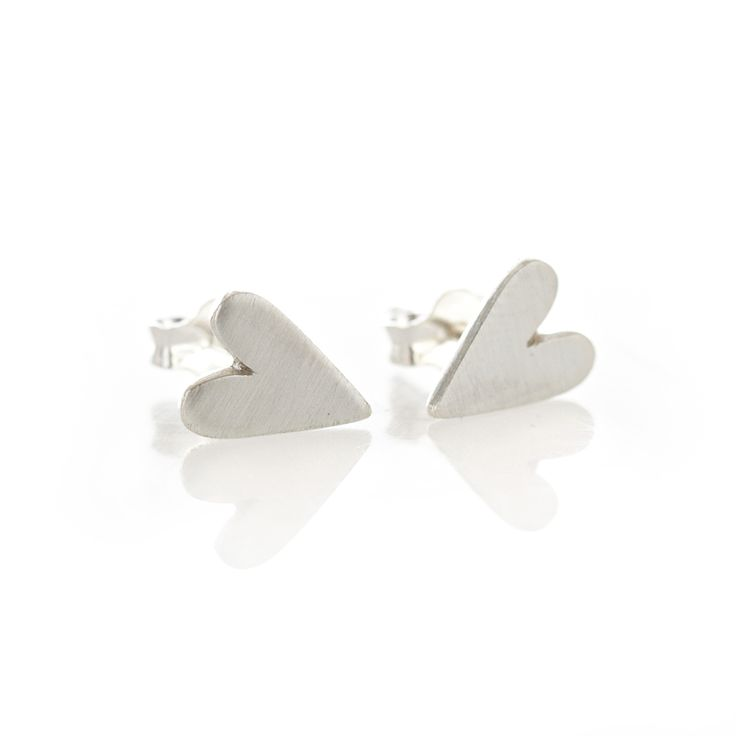 A pair of solid sterling silver, or 9ct yellow gold, heart shaped earrings with a brushed surface.