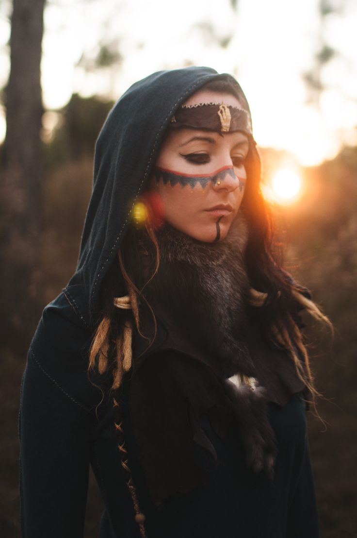 """The face paint in this is beautiful. """"Live to the point of tears."""" ― Albert Camus My latest Look Book ~ Designer: The Gypsies Caravan (https://www.etsy.com/shop/thegypsiescaravan?ref=l2-shopheader-name) Models:Moon Flower, Jun J Bustamante, Cassandra Wahuhi Photography: KMarie Photography """"The Hermit Dress"""" By RunWith TheTribe Flower Crown by Katelyn Demalow"""