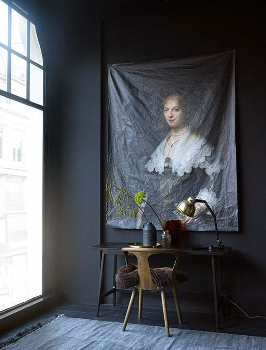 vintage painting printed on canvas hung on black wall over desk. / sfgirlbybay