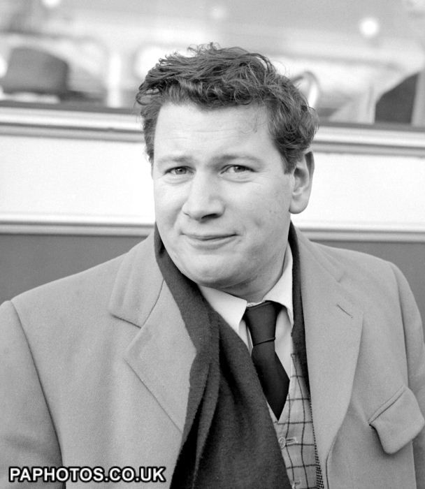 Peter Ustinov, 1955. Actor and writer Peter Ustinov at London Airport, on his way to Paris. He served as a private in the Royal Sussex Regiment in World War Two, and also as batman to David Niven during which time they wrote the film The Way Ahead. S)