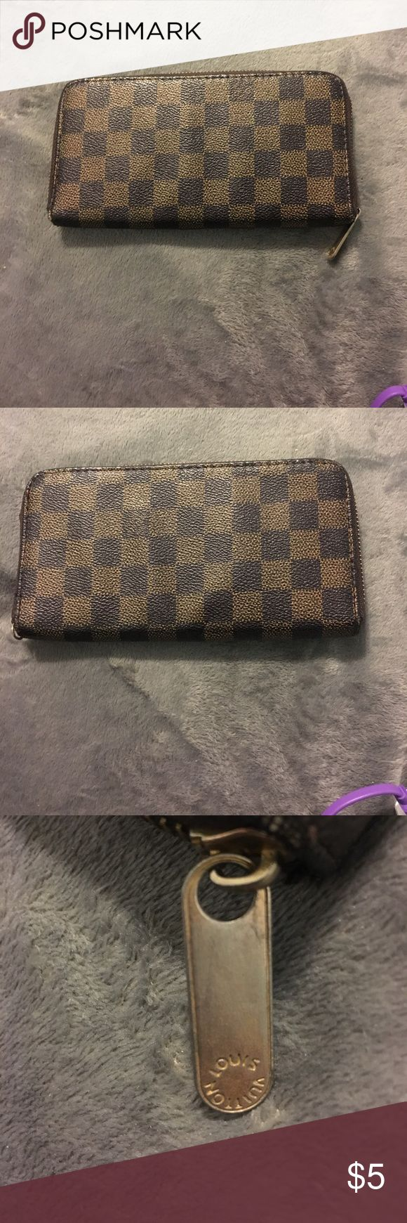 Louis Vuitton wallet! Louis Vuitton Wallet! It is NOT REAL! Missing zipper on inside but outside zipper works just fine! I posted a picture of it compared to my real Louis! Bags Wallets