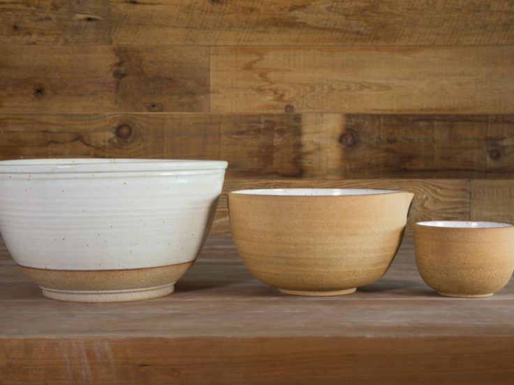 """Wheel thrown clay and glaze. Beautiful enough to do double duty on your kitchen countertop as a fruit bowl, you can make big batches of anything (from dough to summer salads) in this farmhouse mixing bowl by Hanselmann Pottery. Each piece is individually hand thrown, and displays its own characteristics. No two pieces are exactly the same. Microwave, dishwasher, & oven safe. 11"""" x 7"""""""