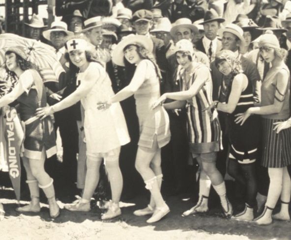 !918 Flappers showing off their bathing costumes.