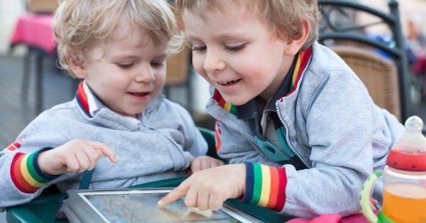 http://www.dreamstime.com/royalty-free-stock-photography-two-brother-toddler-boys-playing-tablet-pc-little-outdoors-image31688757
