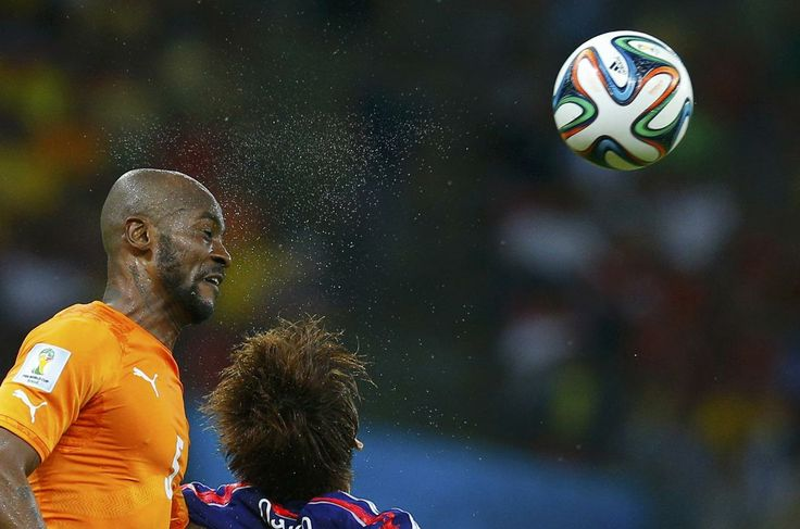 Ivory Coast's Didier Zokora (L) heads the ball during their 2014 World Cup Group C soccer match against Japan at the Pernambuco arena in Recife, June 14, 2014. (Brian Snyder/Reuters)